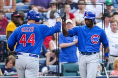 Anthony Rizzo is congratulated by Alfonso Soriano after hitting his second homer with the Cubs on Monday