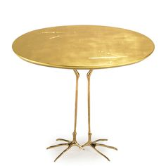 "MERET OPPENHEIM (1913 - 1985) SIMON GAVINA Traccia table, Ultramobile Collection, Italy, 1970s Gold leaf, wood, cast bronze Manufacturer""s l..."