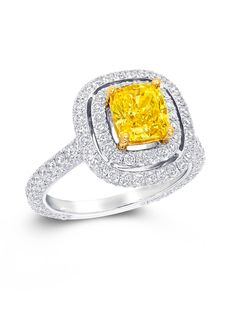 Twin Constellation ring with a double pavé setting surrounding a yellow diamond center. Via www.thejewelleryeditor.com/.