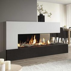 A real panoramic fire in your home: the DRU Metro gas fireplace. A real panoramic fire in your home: the DRU Metro gas fireplace. The DRU Metro gas fi 3 Sided Fireplace, Fireplace Feature Wall, Fireplace Windows, Living Room Decor Fireplace, Home Fireplace, Fireplace Remodel, Home Living Room, Fireplace Modern, Fireplace Showroom