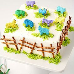 Bake a Barnyard - Stand frosted animal crackers on mounds of green-tinted coconut. Then build a fence with pretzel sticks and icing to create this cool cake your little animal lover will adore.