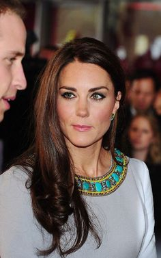 Glossy: Kate's trademark locks were as well-groomed as ever