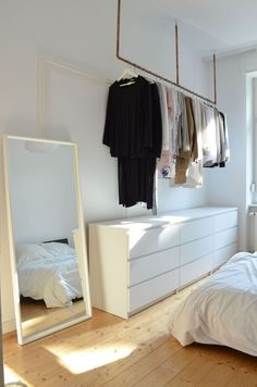 #diy clothes rack on wall