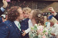 Bride and Groom with their son from a Summer Garden Party Wedding | Photography by http://www.rebeccadouglas.co.uk/