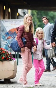 (L-R) Crown Princess Elisabeth and her youngest sister Princess Eleonore arrives for their first day of school at the Sint-Jan-Berchmans college in Brussels on September 1, 2015