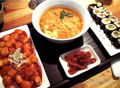 Ddukbokki (Spicy rice cakes), ramyun & kimbap (Korean sushi rolls) with banchan (side dishes)