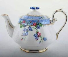 Royal Albert teapot. Harebell pattern. 1927-1940s; Crown China backstamp until 1935, then Bone China backstamp. Cup, Countess shape.