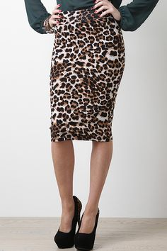 Go for an all rogue look with the Night Leopard Skirt! Featuring leopard print, stretch knit, wide waistband, and asymmetrical hem.