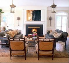 This is how most rooms should be set up. Two sofa's facing each other and one or two chairs capping off the end.