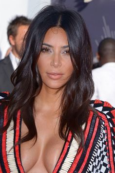 """Kim Kardashian's jaw dropping shoulder-length hair with sleek centre-parted style   To make this hairdo shop our Dark Brown 22"""" Remy Clip in Human Hair Extensions   £49.99   Shop Now: http://www.cliphair.co.uk/22-Inch-Full-Head-Clip-In-Hair-Extensions-Darkest-Brown-2.html"""