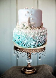 Beach Wedding Theme Cake ~ Ombre Ruffled Frosting See more here: http://www.opulenttreasures.com/shop/chandelier-ball-base-round-cakes-set-of-3