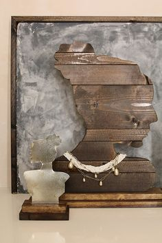 Modern DIY Jewelry Bust  try cardboard silhouette mounted on a block of wood.  Use an old frame and changeable background.  What about a cuphook or tack to hold an earring?