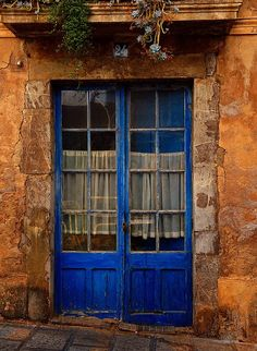 Blue doors. For some reason I really love colored doors. I find the composition of this image rather intriguing.