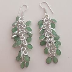 % Chalcedony gemstone SP bezel charm earrings  3 & 1/4 inches long, % bezel green chalcedony (onyx) gem stones, wrapped in Sterling silver overlay to make these unique grapevine, individual, charm earrings. Handmade/crafted, new without tags. Gorgeous, FUN, summer color!! I ❤️ love these earrings, French hook closure!  Handmade Jewelry Earrings