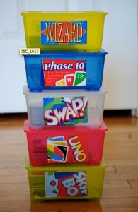 Use baby wipe containers to store card games in.