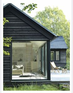 The Vinkelhuset Line is a modular prefab by Møn Huset. Tagged: Exterior, Cabin Building Type, and Prefab Building Type. Photo 3 of 14 in 13 Modern Prefab Cabins You Can Buy Right Now Design Exterior, Black Exterior, Modern Exterior, Exterior Paint, Bungalow Exterior, Exterior Houses, Exterior Shutters, Exterior Cladding, Cottage Exterior