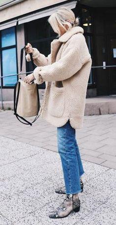 fluffy coat. vintage denim. snake boots.