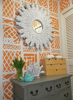 Decor Pad - white sunburst mirror on orange graphic/trellis wallpaper Orange Wallpaper, Graphic Wallpaper, Colorful Wallpaper, Rattan, Hand Painted Walls, Foyer Design, Sunburst Mirror, Orange And Turquoise, Arquitetura