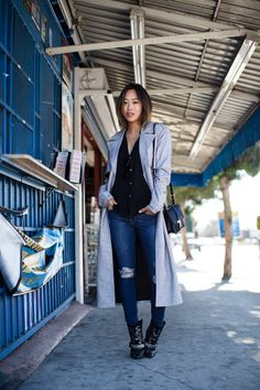 If you're aiming for a more casual style, why not try stealing Aimee Song's simple trench coat look which is perfect for everyday wear. Consisting of ripped denim jeans, embroidered cowboy boots and a marl grey maxi trench, this look is a must wear. Shirt: Ralph Lauren, Coat: Finders Keepers the Label, Jeans: Frame Denim, Bag: Ferragamo Aileen, Boots: Isabel Marant.