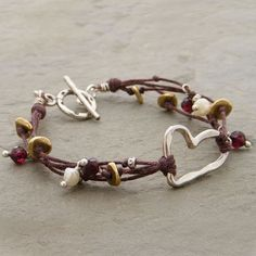 (http://www.elizabethplumbjewelry.com/multiple-strands-and-silver-heart-bracelet/)
