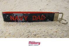 """This handcrafted key chain is proudly Made in America. Our patriotic key chain is just the right size so you'll never lose your keys again! Moreover, this US Navy Dad key chain is the perfect item to show off your military pride.   Handcrafted from genuine military fabric and strong nylon webbing, this key chain will stand the test of time. Excellent gift for yourself and for your Military friends and family members!!! 1""""x6"""""""