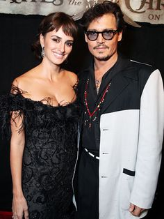 A PREMIERE PAIR  They color coordinated! Penélope Cruz sticks close to her Pirates of the Caribbean: On Stranger Tides costar Johnny Depp at their film's premiere Saturday at Disneyland in Anaheim, Calif. Credit: Eric Charbonneau/WireImage  Published: Tuesday May 10, 2011 | 05:00 PM EDT