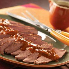 Slow Cooked Brisket -- Slow cook your way to tender beef brisket with this recipe. #Beef #SlowCooker