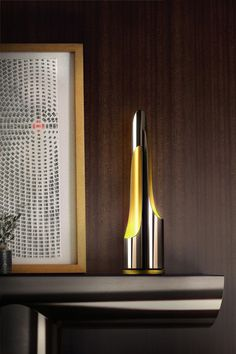 Coltrane Table Lamp - Merely mention the name Coltrane and you feel a deep connection with innovation and the expressive music in jazz. Taking these powerful connections created by John Coltrane our designers have created a monumental design that will withstand time. With 1, 2 or 3 iron tubes, this lamp stands out with a unique and contemporary visual effect.
