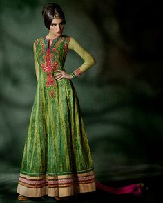 Green And Pink Anarkali Suit with embroidered neckline   1. Drafted in the fabric of net, tissue and dhupion this green and pink Anarkali Suit is sure to add a spark. The kameez is designed and embroidered in aari work on the kalis which is added with a hand and machine embroidery on front neck and armhole. 2. Comes with matching bottom and dupatta3. Sizes available : M, L, XL, XXL