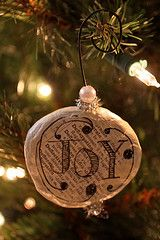 handmade ornament...modge podge newspaper/old book pages, then draw on them with sharpies