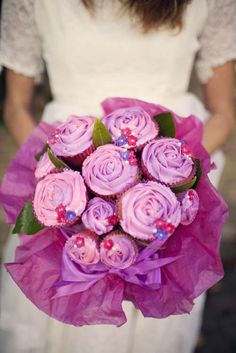 Loving this: Cupcake Bouquet - although this was for a bridal photo shoot - GREAT IDEAl: put this bouquet in a vase to serve the cupcakes for any time or icing colors to coordinate with special occassions and just be able to pull out cupcake with stem/stick :)