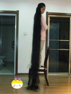 Unknown lady has 2 meters plus long hair