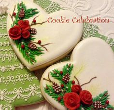 Hearts with pine bows, pine cones, red berries, and red roses. Cookies by Cookie Celebration