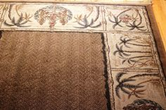 """SOLD @Mohawk Home - Royalty Rug, Bristlecone Brown. RN: 99717. Herringbone pattern center surrounded by a border of Palm Trees and Royal Crests. Evokes Colonial West Indies / Tommy Bahama style. Approximately 5'4"""" x 7'8"""". Great condition. Royalty Rug WAS $ 125. SOLD"""