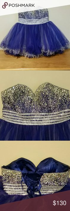 Prom dress This gorgeous purple, ruffled, beaded dress is ideal for any occasion. It has a drawstring backing for added support, and a coordinating sash. Dresses Prom