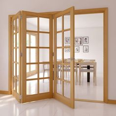 Tri-fold doors open your living space. Choose a wooden frame to create a light natural space.