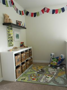 I love the bunting. play area - great use of a small space