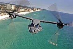 A Bell Boeing V-22 Osprey flying over the Coast in Florida