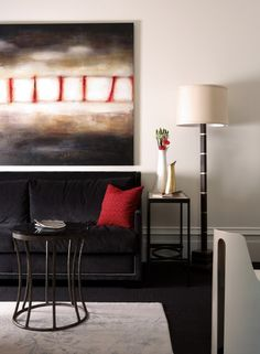 2. Use balance of color. This art has a lot of black with just a little bit of red. The black sofa with just a little red pillow keeps the same balance of colors as the art. Carrying that balance of color though the furnishings spreads the influence of the painting by Dillard Design Group, LLC