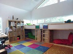 Add a bunk bed and give each kid their own reading nook underneath.  Perfect.