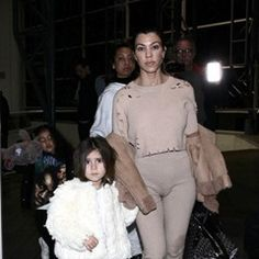 Kourtney Kardashian is seen arriving at LAX with daughter Penelope and niece North West