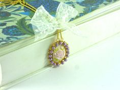 Resin cabochon Rose pendant with white lace and by HirasuGaleri, $35.00