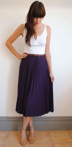 Gorgeous, simple outfit: white top, blue pleated skirt, tan shoes