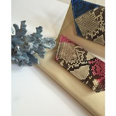 Delicious #Pink and #Blue Snakeskin Sona Clutches in #Italian Leather. #Edgy and #Easy to carry. Available at www.islyhandbags.com #Sona #armcandy #fashion #handbag #islyhandbags #style