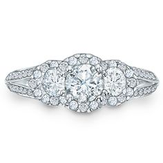 This ring features three round-cut diamonds, the largest being an impressive 1/2 ct., arranged across the center.