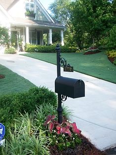 Mailbox landscape with monogram on a rock yard work for Landscaping rocks tuscaloosa al