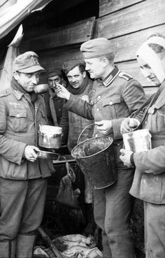 Soldiers of the Wehrmacht sniffing as nasty smells like soup, connecting of guaranties issued rations.