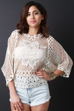 This lovely relaxed fit crochet knit fabrication with rosette design at the front and back. Finished with v neckline, dolman sleeves, and straight hemline. Accessories sold separately. Made in U.S.A.