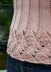 """This top-hip length pullover uses a modified version of """"Chinese Lace,"""" from Barbara Walker's 2nd Treasury of Knitting Patterns. Wide bands of the lace adorn the the cuffs and hem, and then flow into the ribs which give this sweater its flattering fit. In addition, the waist is shaped with decreases and increases, and the three-quarter length sleeves end with a slightly belled cuff. The yarn I used has been discontinued; some possible substitutions include Dale of Norway Svale…"""