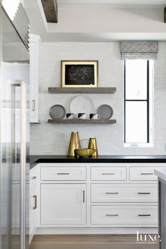 Contemporary White Kitchen Counter With Bronze Accents